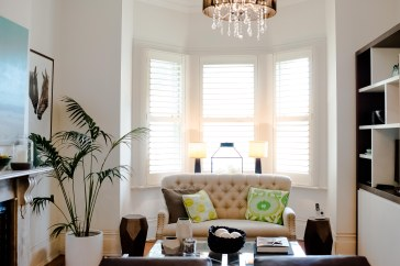 The front living room provides a luxurious escape with a coffee